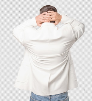 Man from behind touching his head