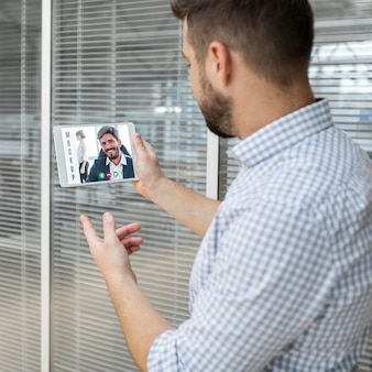 Man having a video conference at work