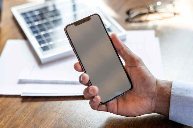 Man holding a blank mobile phone mockup