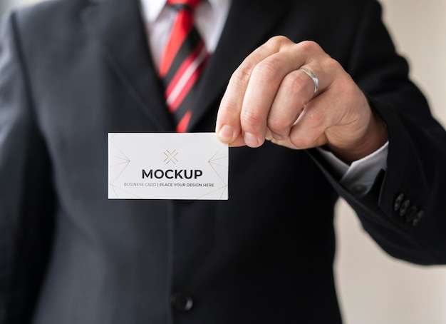 Man holding business card mock-up with one hand
