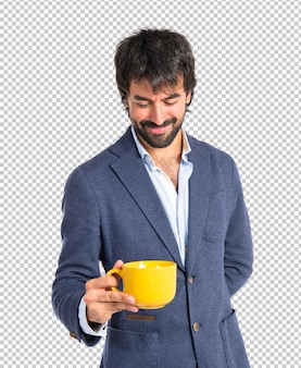 Man holding a cup of coffee over white background