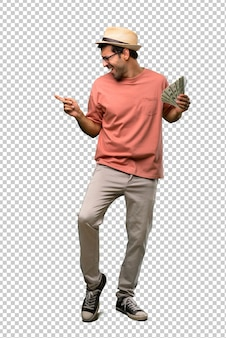 Man holding many bills enjoy dancing while listening to music at a party