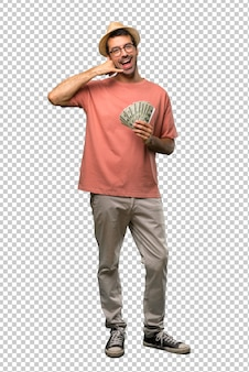 Man holding many bills making phone gesture. call me back sign