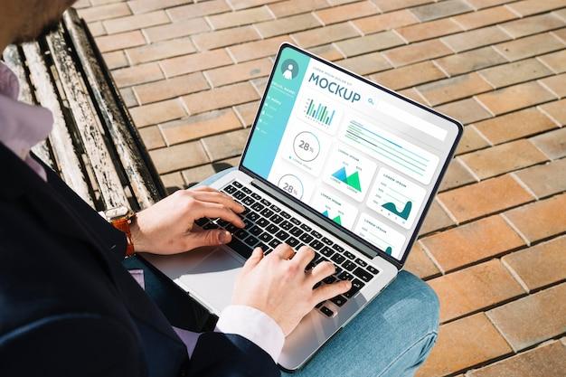 Man holding a mock-up laptop