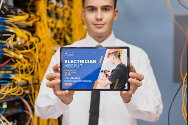 Man holding a mock-up tablet
