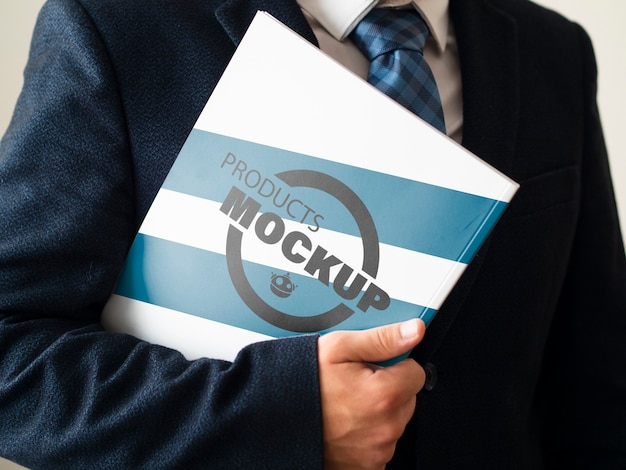 Man holding a notebook mock-up