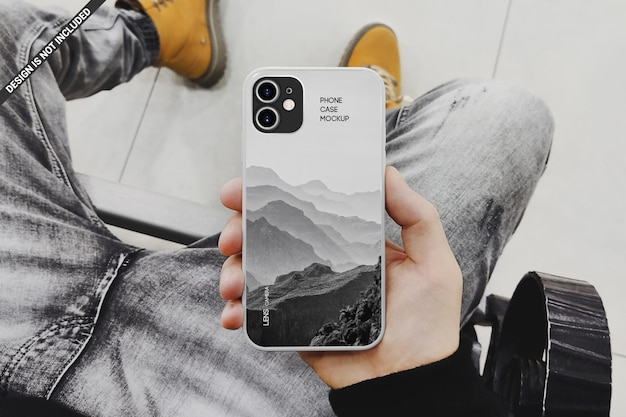Man holding a phone case mockup design isolated