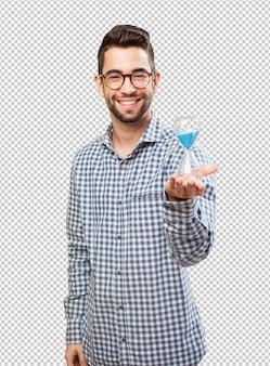 Man holding a sand timer