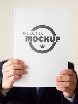 Man holding up a notebook mock-up