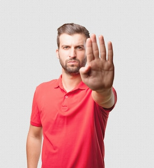 Man in red shirt doing stop sign