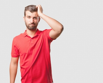 Man in red shirt thinking