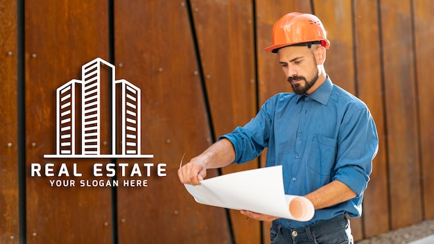 Man looking at plans with hard hat