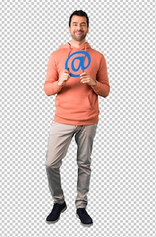 Man in a pink sweatshirt holding icon of at dot com