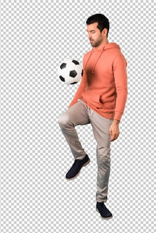 Man in a pink sweatshirt with soccer ball