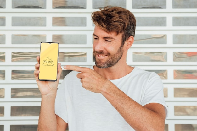 Man pointing at mobile