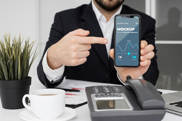 Man pointing to a smartphone mock-up