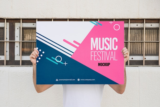 Man presenting poster mockup outdoors