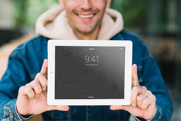 Man presenting tablet mockup