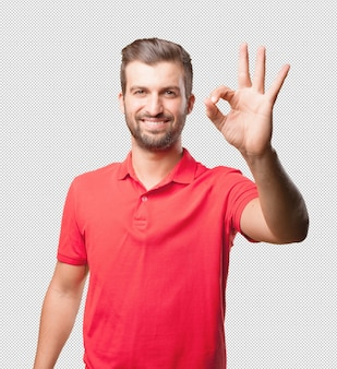 Man in red shirt doing okay gesture