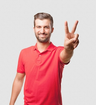 Man in red shirt doing victory gesture