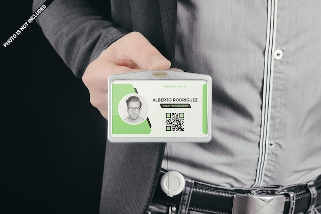 Man showing id card in holder mockup design isolated