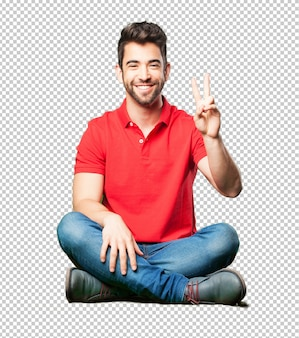 Man sitting doing number two gesture