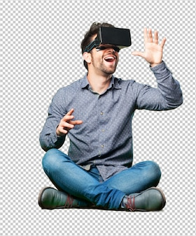 Man sitting on the floor wearing a virtual reality glasses