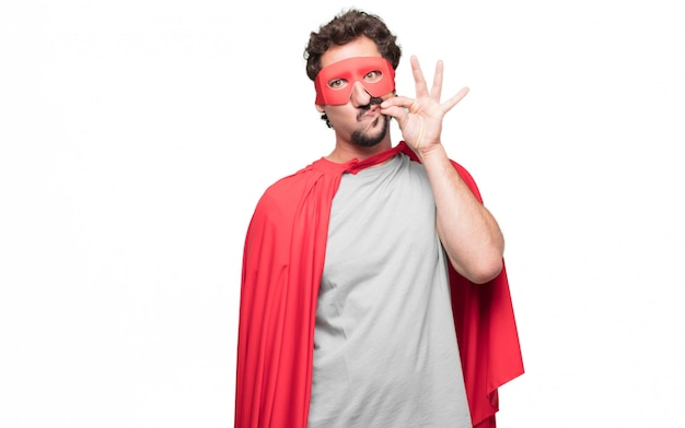 Man in superhero dress showing three fingers