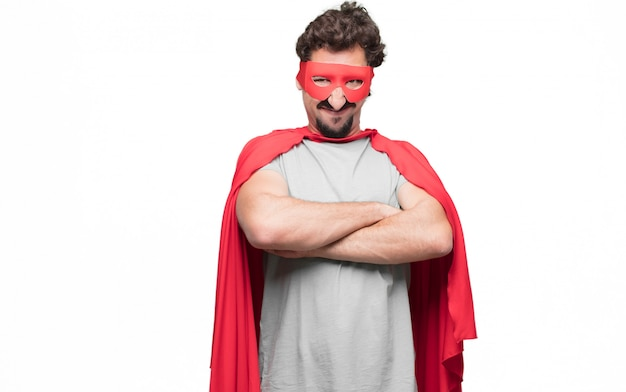 Man in superhero dress with arms crossed