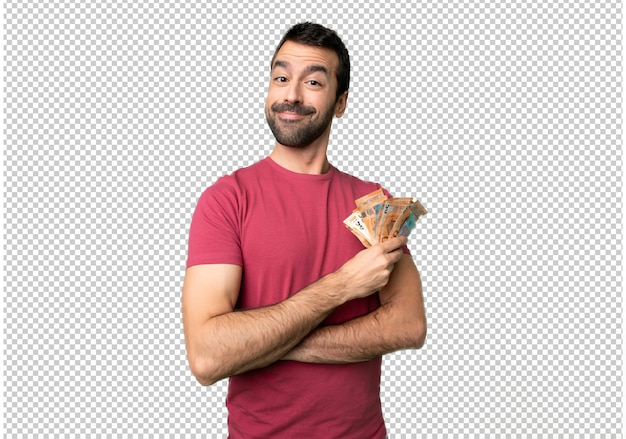 Man taking a lot of money keeping the arms crossed in frontal position