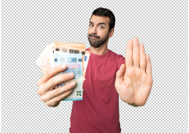 Man taking a lot of money making stop gesture for disappointed with an opinion