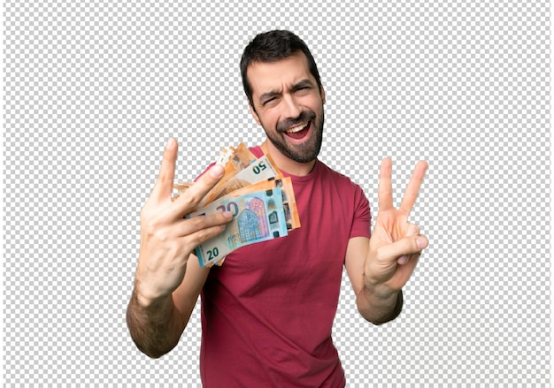 Man taking a lot of money smiling and showing victory sign with both hands