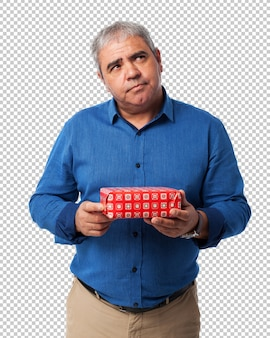 Man thinking with a gift