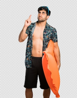 Man in trunks with fingers crossing and wishing the best