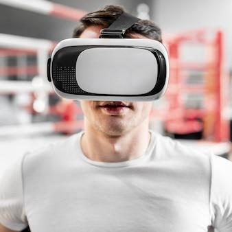 Man using virtual reality goggles at boxing training