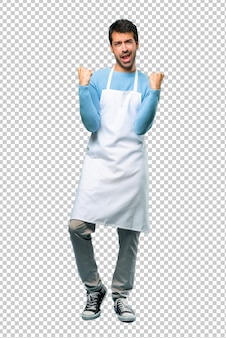 Man wearing an apron celebrating a victory and happy for having won a prize