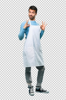 Man wearing an apron proud and self-satisfied in love yourself concept