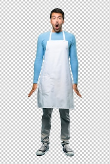 Man wearing an apron with surprise and shocked facial expression