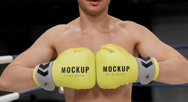 Man wearing boxing gloves mock-up for training
