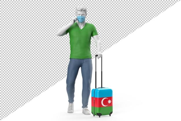 フェイスマスクを身に着けている男は、アゼルバイジャンの旗でテクスチャリングされたスーツケースを引っ張る
