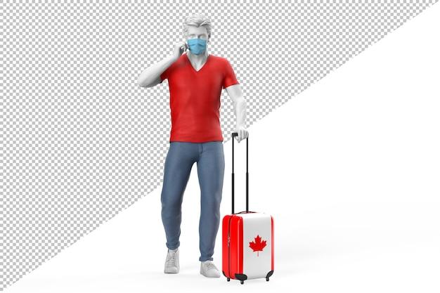 얼굴 마스크를 쓴 남자가 캐나다 국기가 새겨진 여행 가방을 당깁니다.