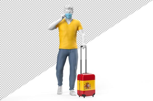 フェイスマスクを身に着けている男は、スペインの旗でテクスチャード加工されたスーツケースを引っ張る