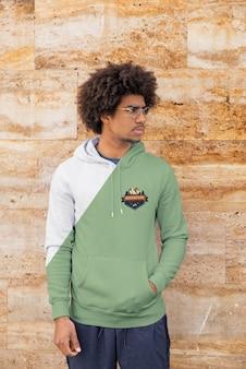 Man wearing hoodie standing