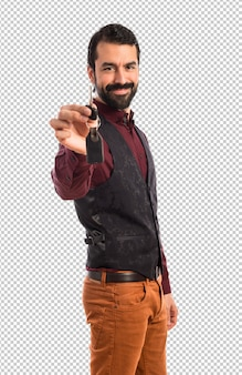 Man wearing waistcoat holding car key