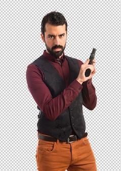 Man wearing waistcoat with a pistol
