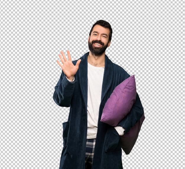 Man with beard in pajamas counting five with fingers