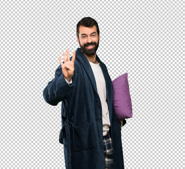 Man with beard in pajamas happy and counting four with fingers