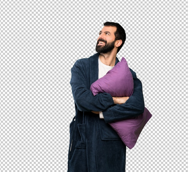 Man with beard in pajamas happy and smiling