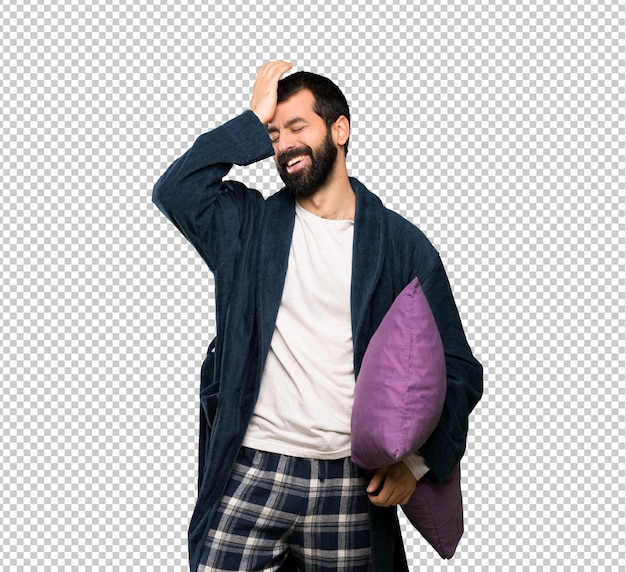 Man with beard in pajamas has realized something and intending the solution