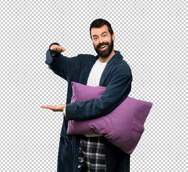 Man with beard in pajamas holding copyspace to insert an ad
